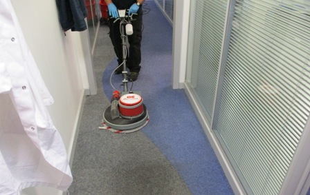 A commercial office carpet being professionally cleaned using the Dry Fusion low moisure system.