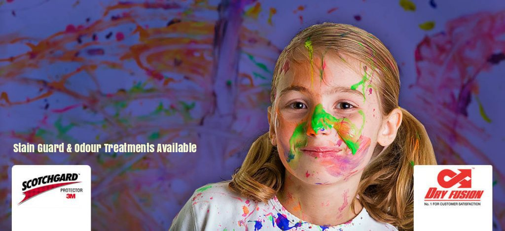 A young girl with colourful paint on her face.