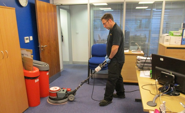 Office carpet being cleaned using the Dry Fusion System.